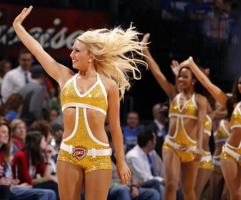 Photo - The Thunder Girls dance team performs during an NBA game between the Oklahoma City Thunder and the Utah Jazz at Chesapeake Energy Arena in Oklahoma CIty, Tuesday, Feb. 14, 2012. Photo by Bryan Terry, The Oklahoman