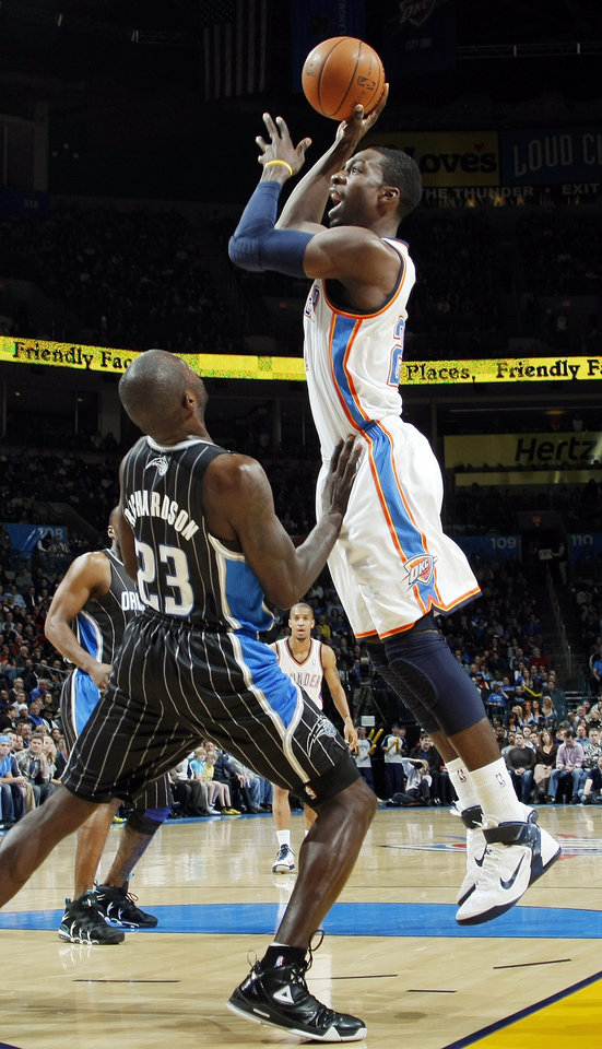 Photo - Oklahoma City's Jeff Green (22) shoots over Jason Richardson (23) of Orlando during the NBA basketball game between the Orlando Magic and Oklahoma City Thunder in Oklahoma City, Thursday, January 13, 2011. Photo by Nate Billings, The Oklahoman