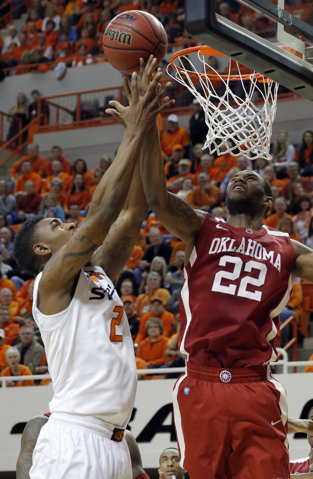 Photo - Oklahoma State's Le'Bryan Nash (2) shoots as Oklahoma's Amath M'Baye (22) defends during the Bedlam men's college basketball game between the Oklahoma State University Cowboys and the University of Oklahoma Sooners at Gallagher-Iba Arena in Stillwater, Okla., Saturday, Feb. 16, 2013. Photo by Sarah Phipps, The Oklahoman