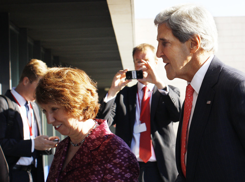 Photo - U.S. Secretary of State John Kerry, right, and European Union Foreign Policy Chief Catherine Ashton walks after arriving for an informal meeting of EU ministers for Foreign Affairs at the National Art Gallery in Vilnius, Lithuania, Saturday, Sept. 7, 2013. Kerry is in Europe courting international support for a possible U.S. strike on the Syrian regime for its alleged use of chemical weapons. (AP Photo/Mindaugas Kulbis)