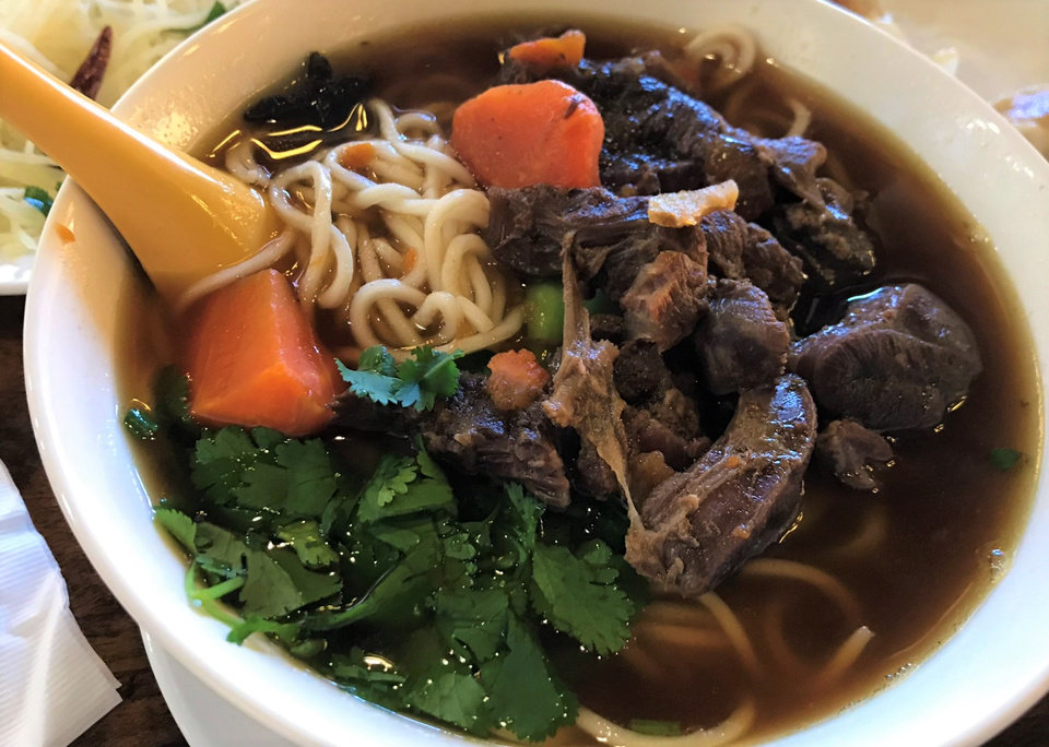 Photo - Noodle soup with beef shank from Northern Noodle House in Oklahoma City. [Dave Cathey/The Oklahoman]