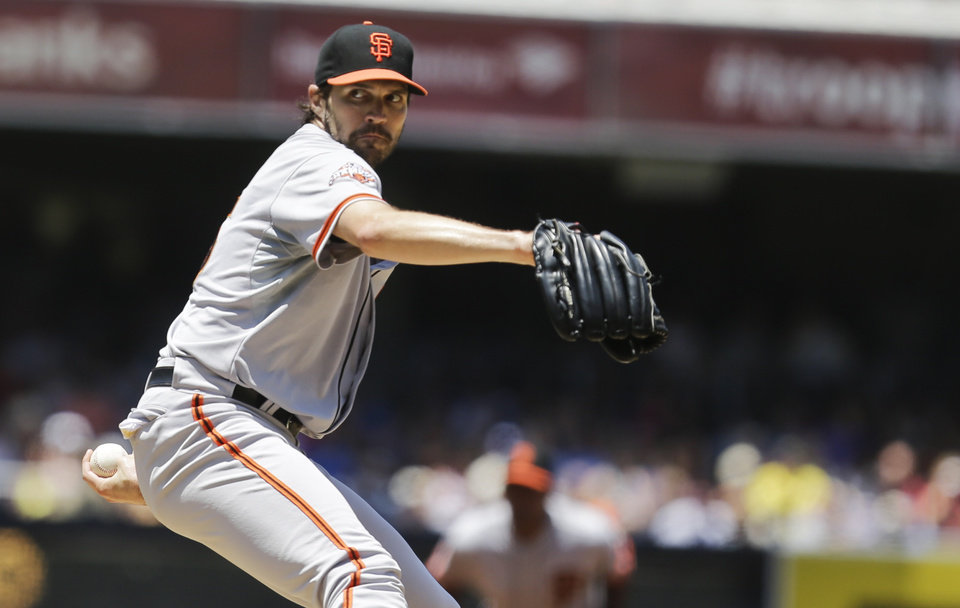 Photo - San Francisco Giants starting pitcher Barry Zito works against the San Diego Padres in the first inning of a baseball game in San Diego, Sunday, July 14, 2013. Zito only pitched two innings before being relieved. (AP Photo/Lenny Ignelzi)