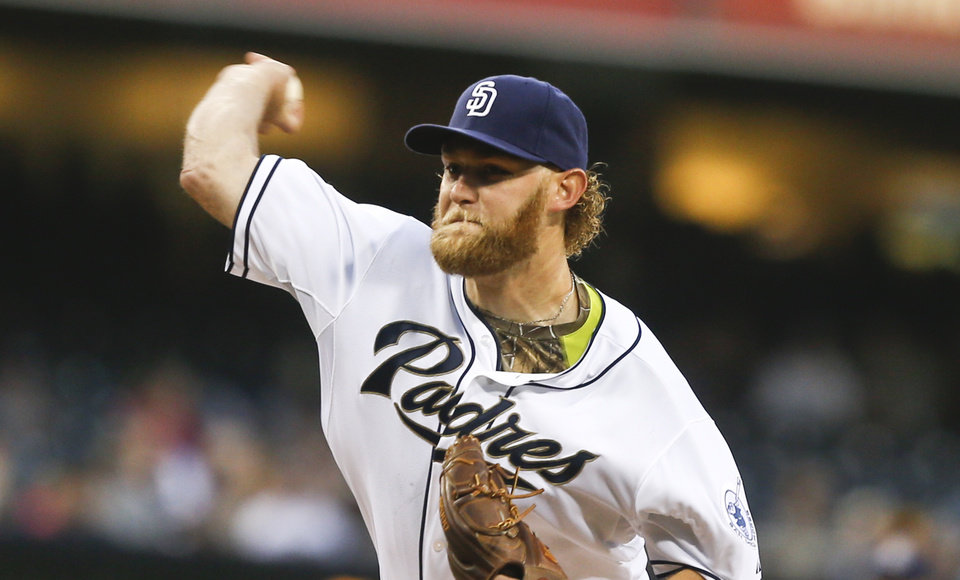 Photo - San Diego Padres starting pitcher Andrew Cashner works against the Colorado Rockies in the first inning of a baseball game Wednesday, April 16, 2014, in San Diego.  (AP Photo/Lenny Ignelzi)