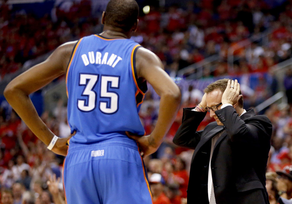 Photo - Oklahoma City's Kevin Durant (35) and Scott Brooks react to a foul called on Durant during Game 3 of the Western Conference semifinals in the NBA playoffs between the Oklahoma City Thunder and the Los Angeles Clippers at the Staples Center in Los Angeles, Friday, May 9, 2014. Photo by Nate Billings, The Oklahoman