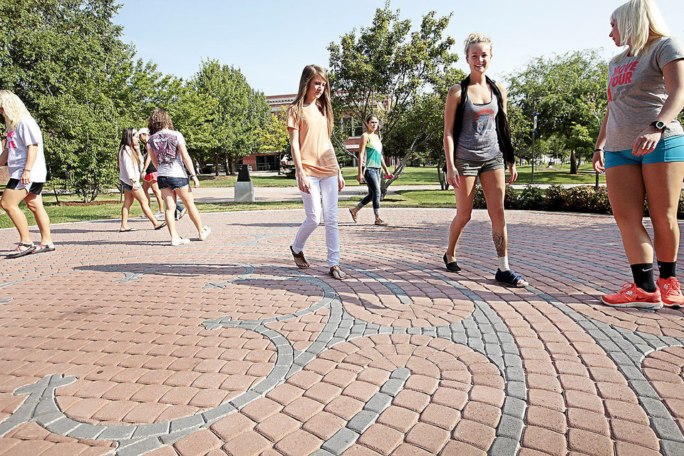 Photo - UNIVERSITY OF CENTRAL OKLAHOMA: UCO Department of Kinesiology and Health Studies students walks the new labyrinth, Thursday , August 22, 2013. Photo by David McDaniel, The Oklahoman