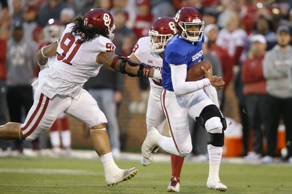 Photo - Oklahoma's Jalen Hurts (1) scrambles past Oklahoma's Dillon Faamatau (91) and Oklahoma's Bryan Mead (38) during the University of Oklahoma (OU) spring football game at Gaylord Family-Oklahoma Memorial Stadium in Norman, Okla., Friday, April 12, 2019. Photo by Bryan Terry, The Oklahoman