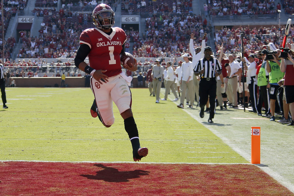 Photo - Oklahoma's Jalen Hurts (1) runs for a touchdown during a college football game between the University of Oklahoma Sooners (OU) and the West Virginia Mountaineers at Gaylord Family-Oklahoma Memorial Stadium in Norman, Okla, Saturday, Oct. 19, 2019. Oklahoma won 52-14. [Bryan Terry/The Oklahoman]