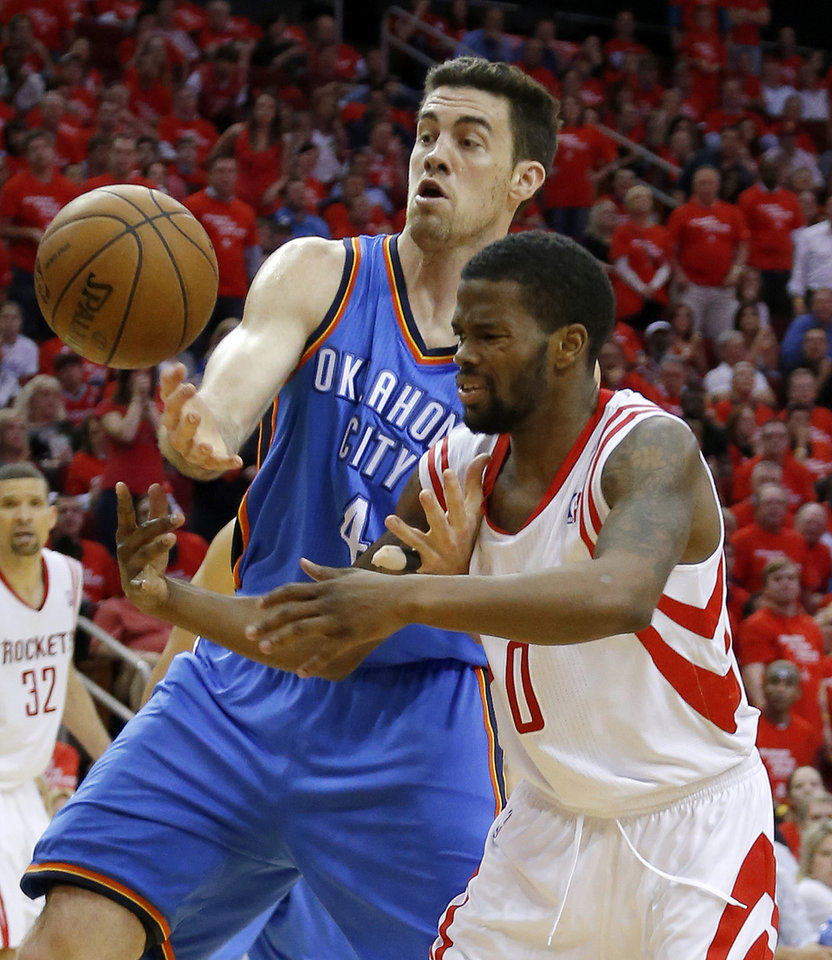 Photo - Oklahoma City's Nick Collison (4) fights with Houston's Aaron Brooks (0) for the ball during Game 4 in the first round of the NBA playoffs between the Oklahoma City Thunder and the Houston Rockets at the Toyota Center in Houston, Texas,Sunday, April 29, 2013. Oklahoma City lost 105-103. Photo by Bryan Terry, The Oklahoman