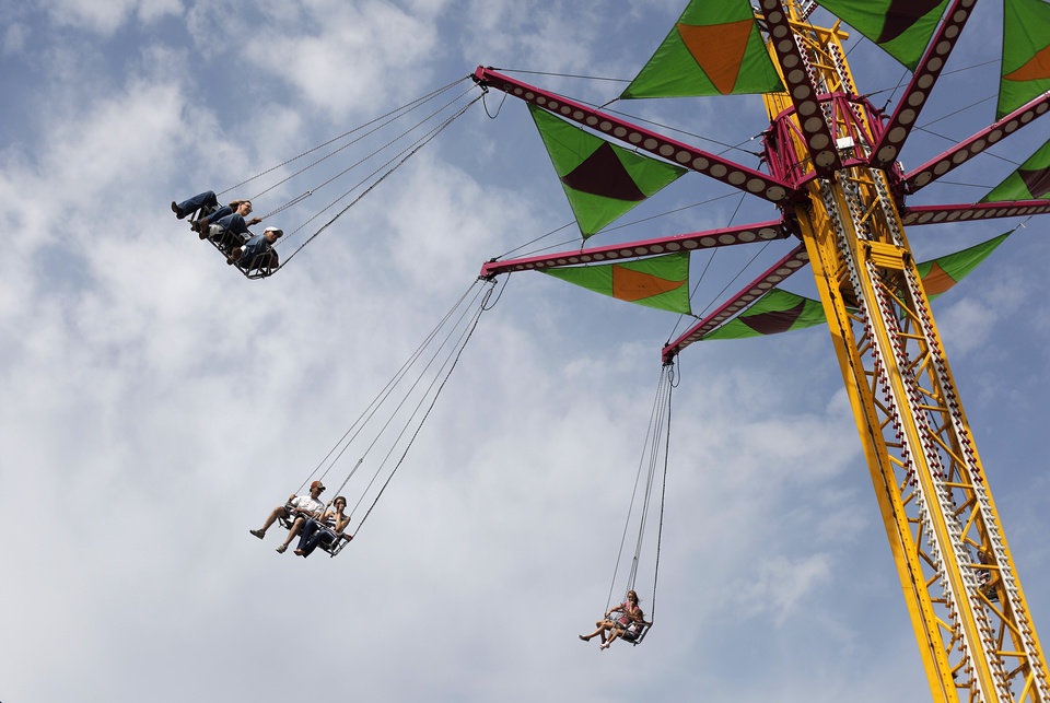 Patrons enjoy the rides at the Oklahoma State Fair, Sunday, Sept. 23, 2012.  Photo by Garett Fisbeck, The Oklahoman