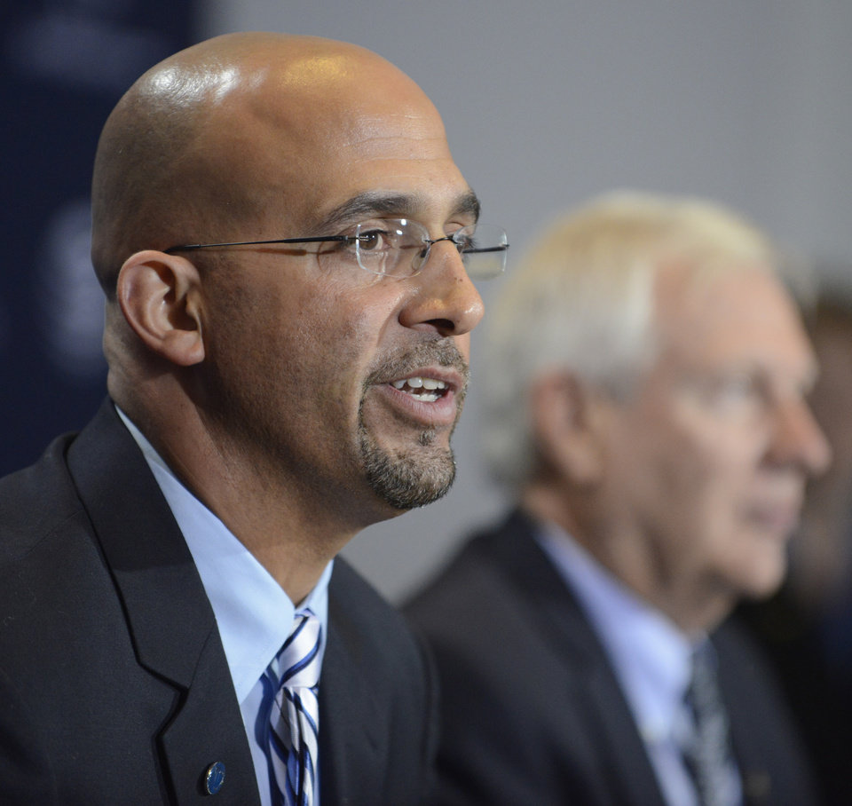 Photo - James Franklin, foreground, is introduced as Penn State's new football coach during a news conference on Saturday Jan. 11, 2014, in State College, Pa. Penn State president Rodney Erickson, background, looks on. (AP Photo/ John Beale)