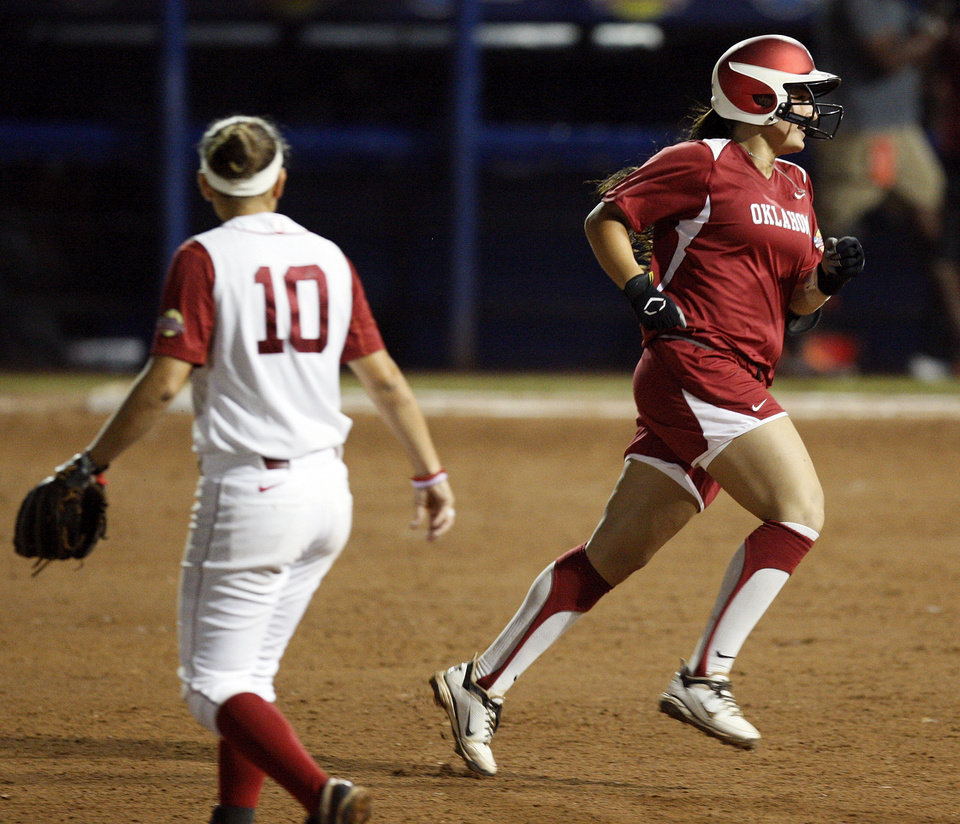 Oklahoma's Lauren Chamberlain (44) runs the bases past Kaila Hunt (10) of Alabama after hitting a 2-run home run in the third inning during Game 3 of the Women's College World Series softball championship between OU and Alabama at ASA Hall of Fame Stadium in Oklahoma City, Wednesday, June 6, 2012.  Photo by Nate Billings, The Oklahoman