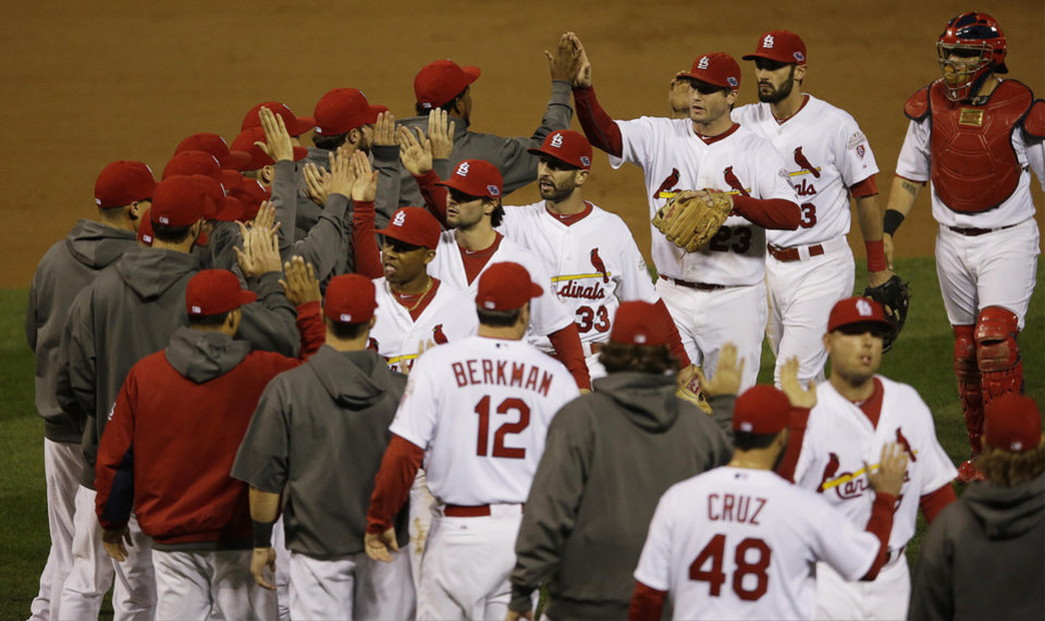 Photo -   St. Louis Cardinals celebrate after beating the San Francisco Giants 3-1 in Game 3 of baseball's National League championship series Wednesday, Oct. 17, 2012, in St. Louis. St. Louis won 3-1. (AP Photo/Patrick Semansky)