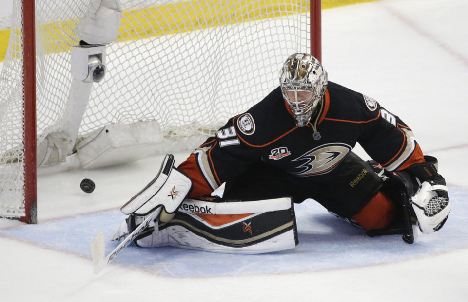 Photo - The puck hit by Dallas Stars' Tyler Seguin enters the net past Anaheim Ducks goalie Frederik Andersen, of Denmark, during the third period in Game 1 of the first-round NHL hockey Stanley Cup playoff series on Wednesday, April 16, 2014, in Anaheim, Calif. The Ducks won 4-3. (AP Photo/Jae C. Hong)