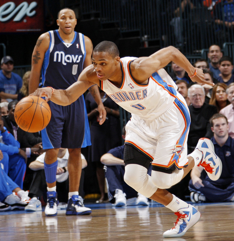 Oklahoma City's Russell Westbrook (0) takes the ball on a fast break after a steal in the fourth quarter during an NBA basketball game between the Oklahoma City Thunder and the Dallas Mavericks at Chesapeake Energy Arena in Oklahoma City, Thursday, Dec. 29, 2011. In the background Shawn Marion (0) of Dallas. Oklahoma City won, 104-102. Photo by Nate Billings, The Oklahoman