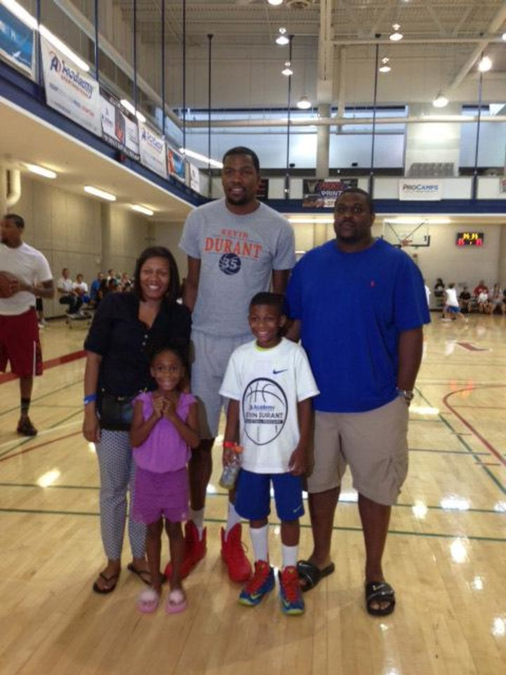 Photo - Eight-year-old Jay Fair and his family with Kevin Durant. From left to right: Christina Fair, Cameryn Fair, Kevin Durant, Jay Fair and Jamie Fair. PHOTO PROVIDED