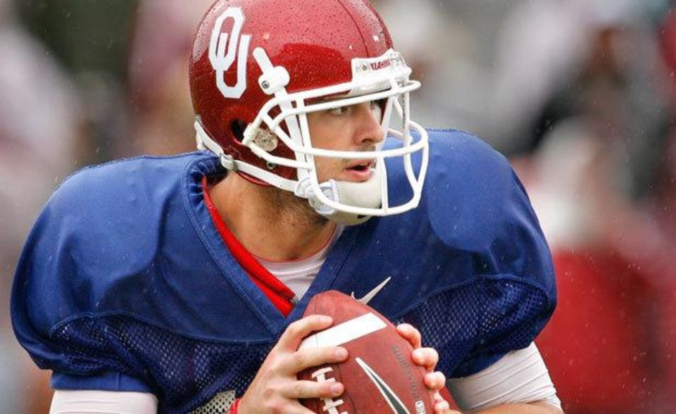 Quarterback Landry Jones rolls out for a pass during the spring Red and White football game for the University of Oklahoma (OU) Sooners at Gaylord Family -- Oklahoma Memorial Stadium on Saturday, April 17, 2010, in Norman, Okla.  Photo by Steve Sisney, The Oklahoman