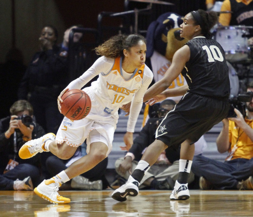 Photo - Tennessee guard Meighan Simmons (10) drives past Vanderbilt guard Christina Foggie (10) in the second half of an NCAA college basketball game, Monday, Feb. 10, 2014, in Knoxville, Tenn. Tennessee won 81-53. (AP Photo/Wade Payne)