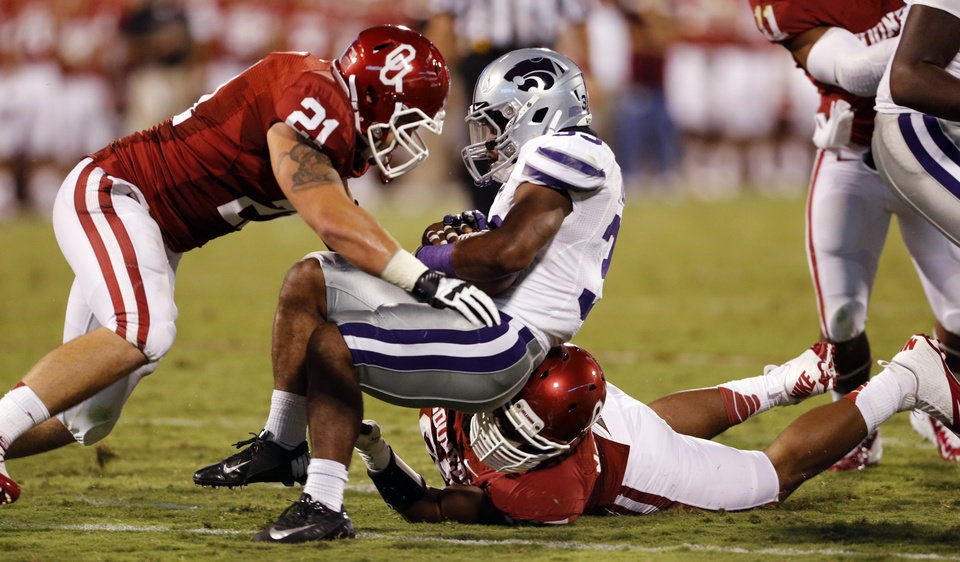 Photo - Tom Wort (21) and Jamarkus McFarland (97) stop John Hubert (33) near the goal in the first half during a college football game between the University of Oklahoma Sooners (OU) and the Kansas State University Wildcats (KSU) at Gaylord Family-Oklahoma Memorial Stadium, Saturday, September 22, 2012. Photo by Steve Sisney, The Oklahoman