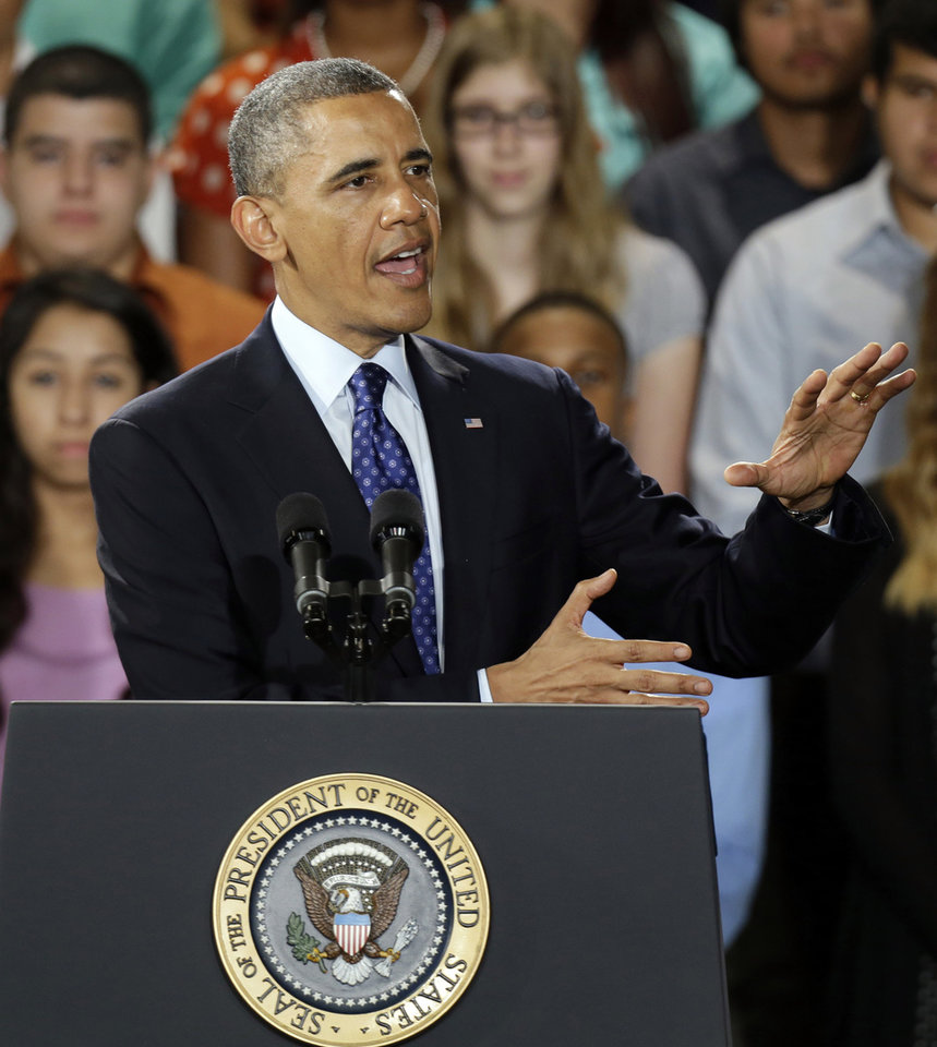 Photo - President Barack Obama speaks during a visit to the Manor New Tech High School in Manor, Texas, Thursday, May 9, 2013. (AP Photo/LM Otero)