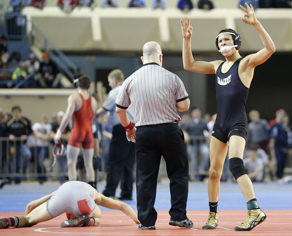 Photo - Broken Arrow's Davion Jefferies celebrates after beating Tulsa Union's Luke Wolfenberger in a semifinal 126 pound match in the Class 6A state wrestling tournament at Jim Norick Arena at State Fair Park in Oklahoma City, Friday, Feb., 28, 2014. Photo by Bryan Terry, The Oklahoman