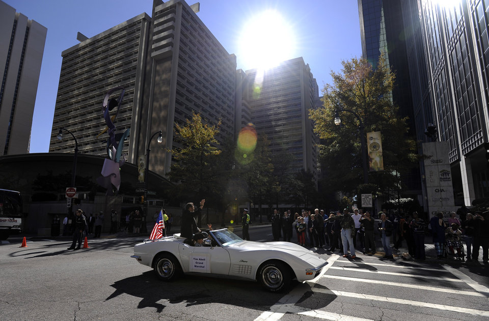 Grand Marshall, actor and U.S. Army veteran Tim Abell starts the 31st annual Veterans Day Parade aboard a Corvette on Peachtree Street in downtown Atlanta, Saturday, Nov. 10, 2012. (AP Photo/David Tulis)