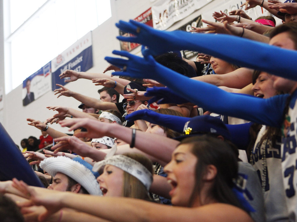 Photo - The Hennessey student section attempts to distract Millwood's free throw shooter during the 2A Girls quarterfinals game between Hennessey and Millwood at Westmoore High School on Thursday, March 13, 2014. Millwood defeated Hennessey 34-27. Photo by KT King, The Oklahoman