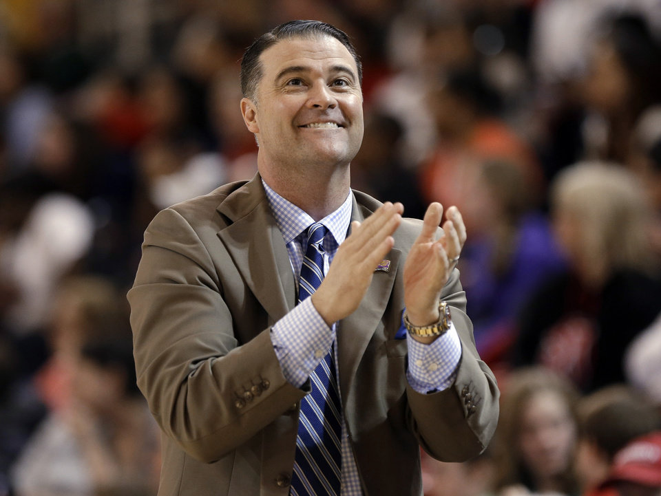 Kentucky coach Matthew Mitchell reacts to a call in the first half of a second-round game against Dayton in the NCAA women's college basketball tournament Tuesday, March 26, 2013, in New York. (AP Photo/Frank Franklin)