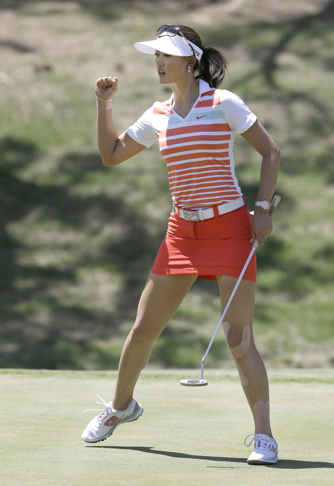 Photo - Michelle Wie reacts to sinking her putt on the 12th hole during the final round of the North Texas LPGA Shootout golf tournament at Las Colinas Country Club in Irving, Texas, Sunday, May 4, 2014. (AP Photo/LM Otero)