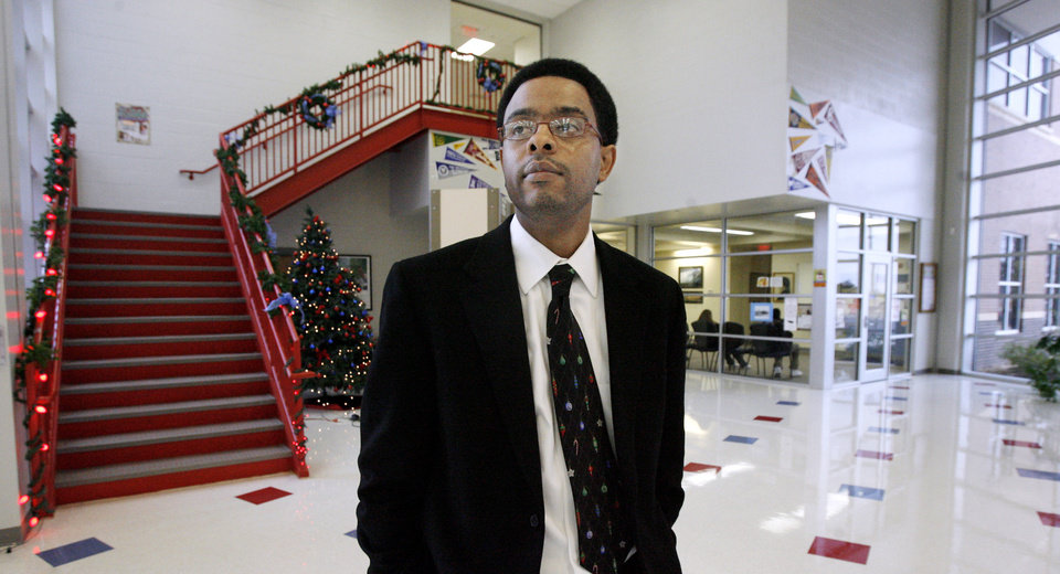 Photo - Principal Corey Harris walking through the atrium at the front entrance at John Marshall High School in Oklahoma City Monday, Dec. 15, 2008. BY PAUL B. SOUTHERLAND, THE OKLAHOMAN