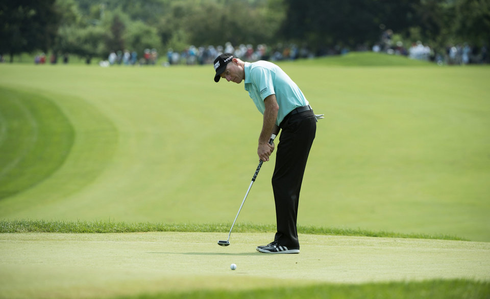 Photo - Jim Furyk putts for a birdie on the sixth hole during second round play at the Canadian Open golf championship Friday, July 25, 2014 in Montreal. (AP Photo/The Canadian Press, Paul Chiasson)