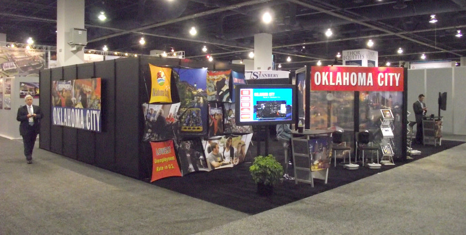 Photo - Oklahoma City's booth is shown at the International Council of Shopping Center conference this week in Las Vegas.  Photos PROVIDED BY THE GREATER OKLAHOMA CITY CHAMBER