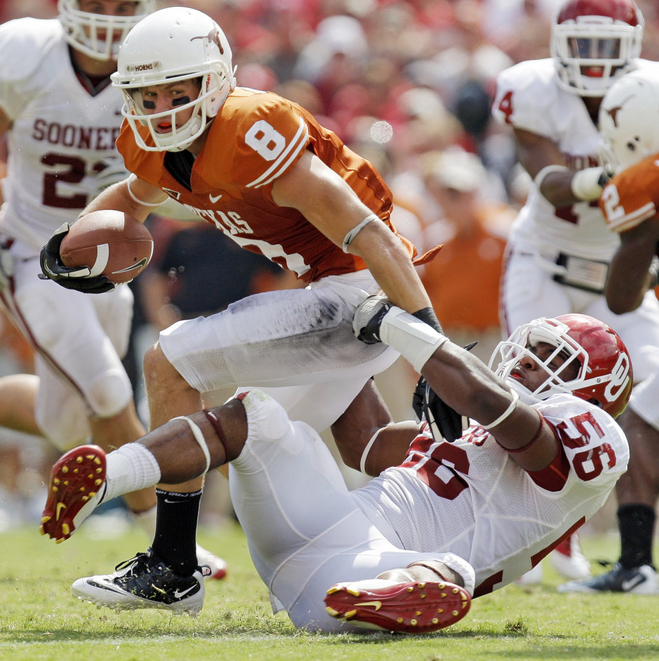 Photo - OU's Ronnell Lewis (56) takes down UT's Jaxon Shipley (8) for a loss in the second half during the Red River Rivalry college football game between the University of Oklahoma Sooners (OU) and the University of Texas Longhorns (UT) at the Cotton Bowl in Dallas, Friday, Oct. 7, 2011. OU won, 55-17. Photo by Nate Billings, The Oklahoman