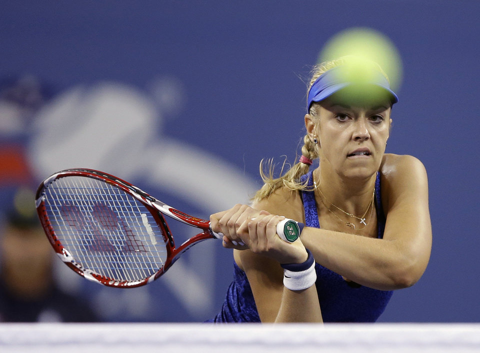 Photo - Sabine Lisicki, of Germany, returns a shot to Maria Sharapova, of Russia, during the third round of the 2014 U.S. Open tennis tournament Friday, Aug. 29, 2014, in New York. (AP Photo/Darron Cummings)