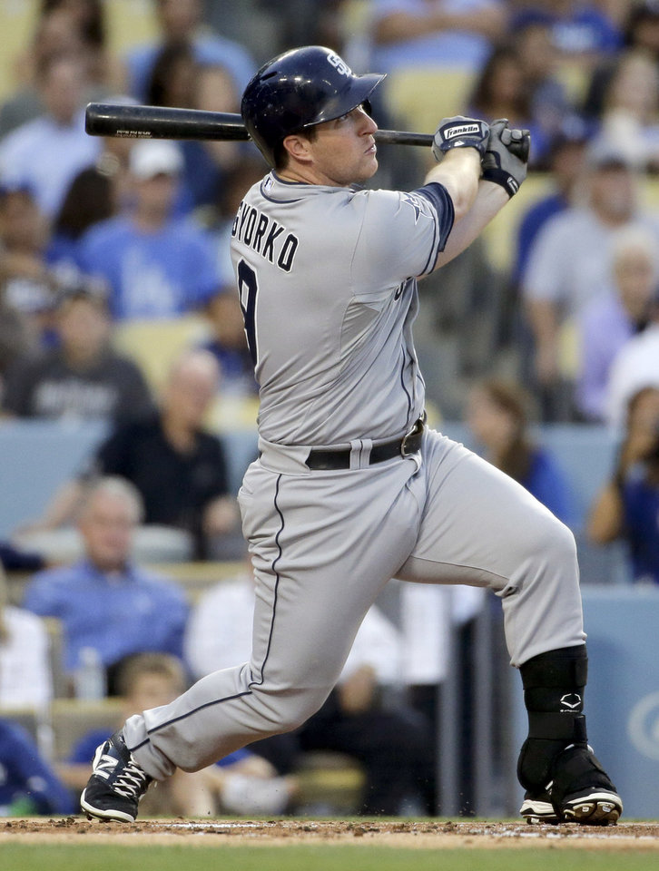 Photo - San Diego Padres' Jedd Gyorko watches his three-run home run against the Los Angeles Dodgers during first inning of a baseball game in Los Angeles, Tuesday, Aug. 19, 2014. (AP Photo/Chris Carlson)