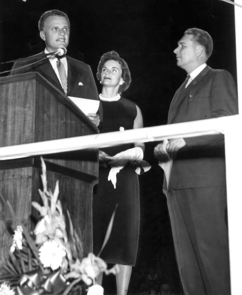 Photo - Honorary citizenship in Oklahoma was presented to evangelist Billy Graham and his wife by Gov. Raymond Gary Saturday night before the sermon during Graham's crusade meeting at the state fairgrounds.  Evangelist Billy Graham in Oklahoma City. Staff photo by Dawes Fisher taken 6/30/1956.