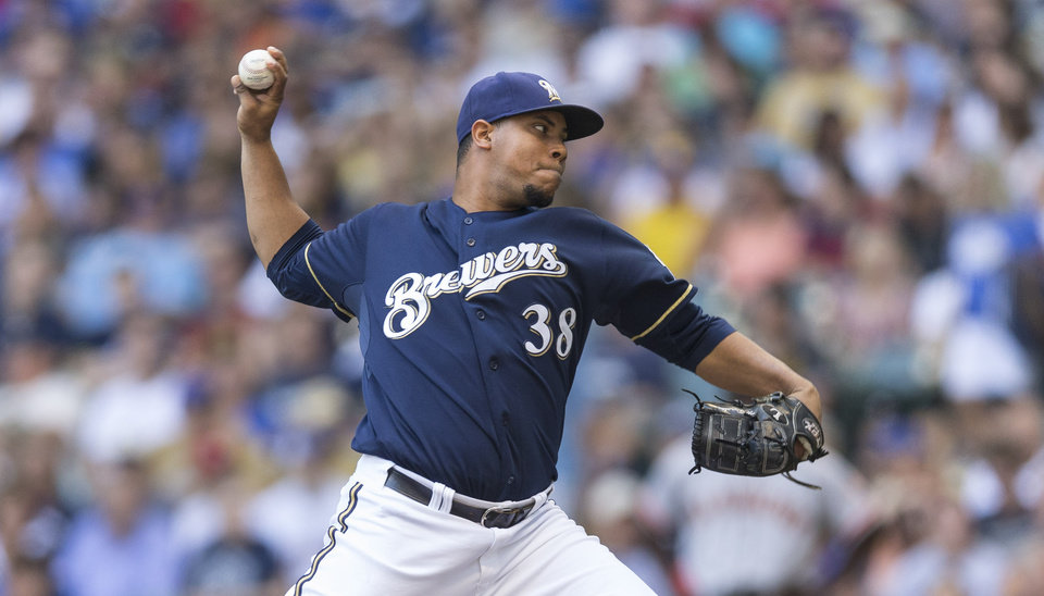 Photo - Milwaukee Brewers' Wily Peralta pitches to a San Francisco Giants' batter during the first inning of a baseball game Thursday, Aug. 7, 2014, in Milwaukee. (AP Photo/Tom Lynn)