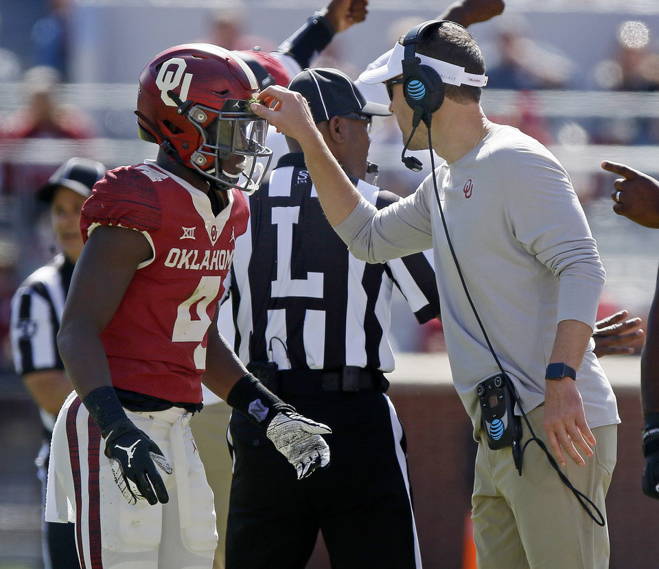 Photo - Oklahoma coach Lincoln Riley picks turf from the helmet of Jaden Davis during a college football game between the University of Oklahoma Sooners (OU) and the West Virginia Mountaineers at Gaylord Family-Oklahoma Memorial Stadium in Norman, Okla, Saturday, Oct. 19, 2019. Oklahoma won 52-14. [Bryan Terry/The Oklahoman]