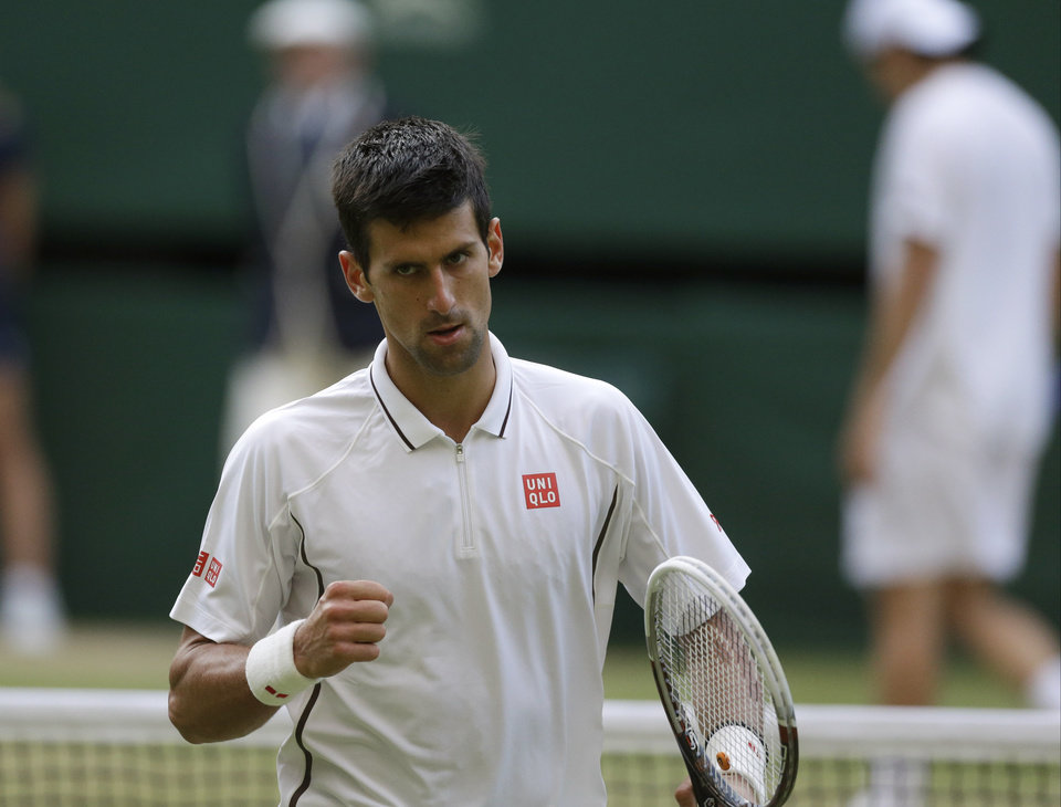 Novak Djokovic of Serbia reacts during his Men\'s singles match against Tommy Haas of Germany at the All England Lawn Tennis Championships in Wimbledon, London, Monday, July 1, 2013. (AP Photo/Anja Niedringhaus)