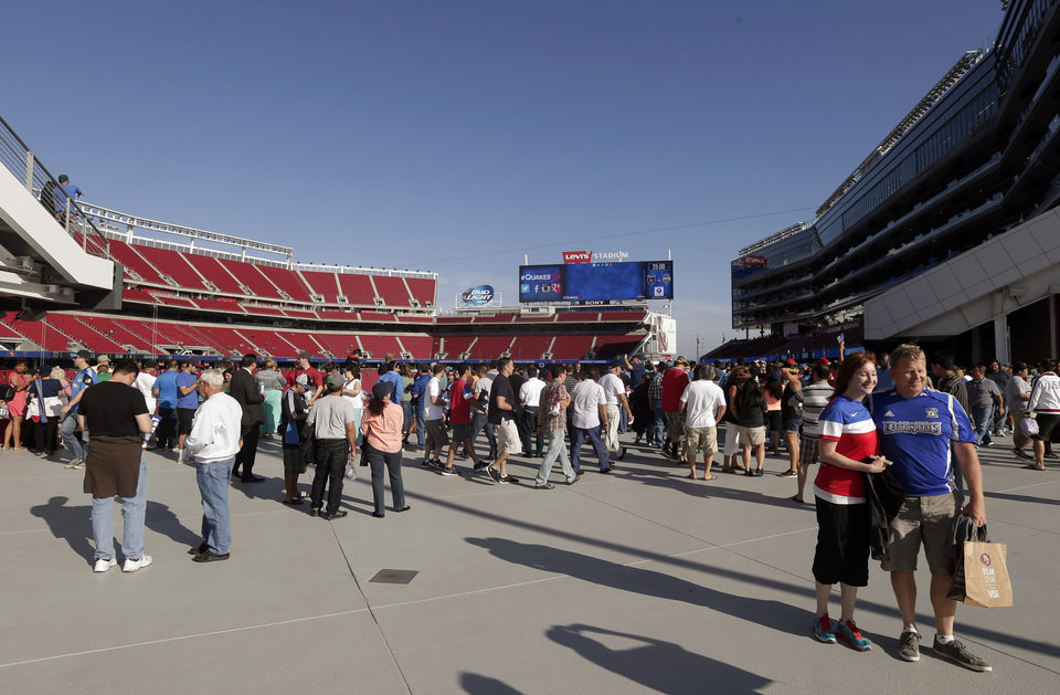 Photo - Fans taken in views of the new Levi's Stadium before an MLS soccer match between the San Jose Earthquakes and the Seattle Sounders on Saturday, Aug. 2, 2014, in Santa Clara, Calif. (AP Photo/Marcio Jose Sanchez)