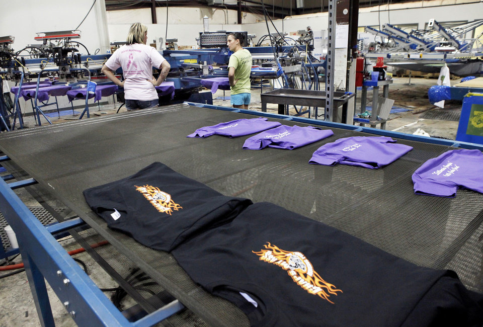 Photo - Shirts in production at Eskimo Joe's Promotional Products in Stillwater. Photo by Jim Beckel, THE OKLAHOMAN