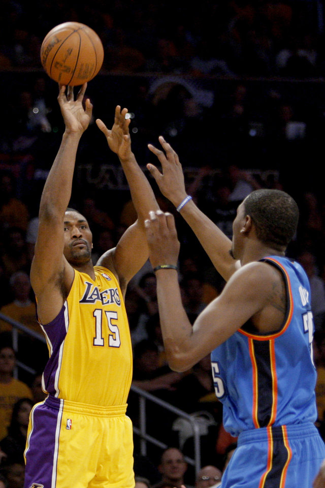 Photo - Los Angeles' Metta World Peace (15) shoots over Oklahoma City's Kevin Durant (35) during Game 3 in the second round of the NBA basketball playoffs between the L.A. Lakers and the Oklahoma City Thunder at the Staples Center in Los Angeles, Friday, May 18, 2012. Photo by Nate Billings, The Oklahoman