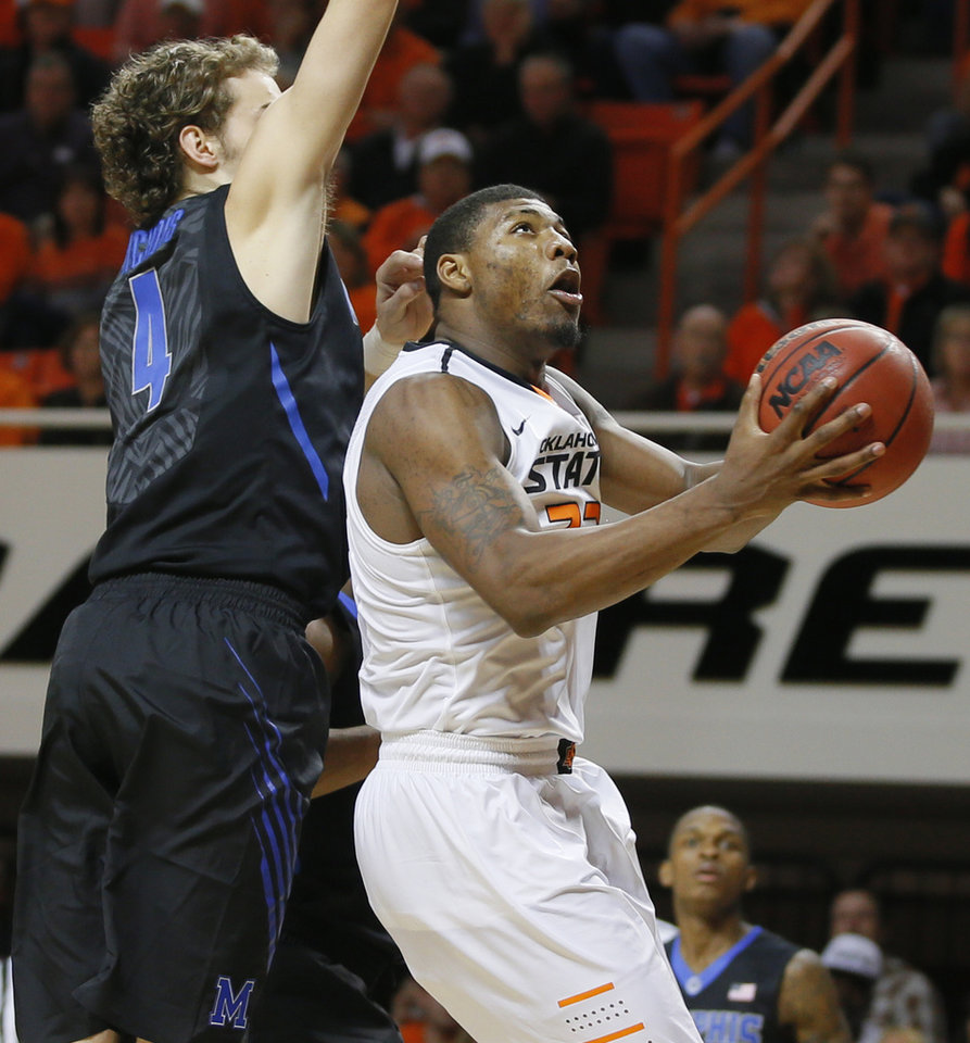Photo - Oklahoma State's Marcus Smart (33) goes past Memphis' Austin Nichols (4) during an NCAA college basketball game between Oklahoma State and Memphis at Gallagher-Iba Arena in Stillwater, Okla., Tuesday, Nov. 19, 2013. Photo by Bryan Terry, The Oklahoman