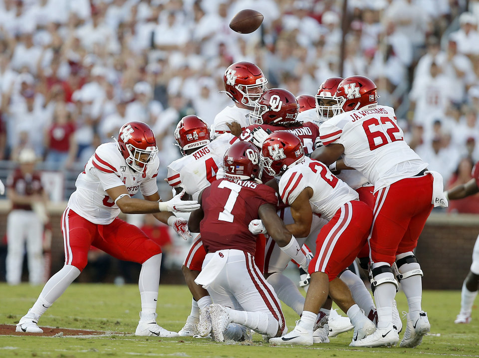 Photo - Houston's D'Eriq King (4) loses the ball during a college football game between the University of Oklahoma Sooners (OU) and the Houston Cougars at Gaylord Family-Oklahoma Memorial Stadium in Norman, Okla., Sunday, Sept. 1, 2019. [Bryan Terry/The Oklahoman]