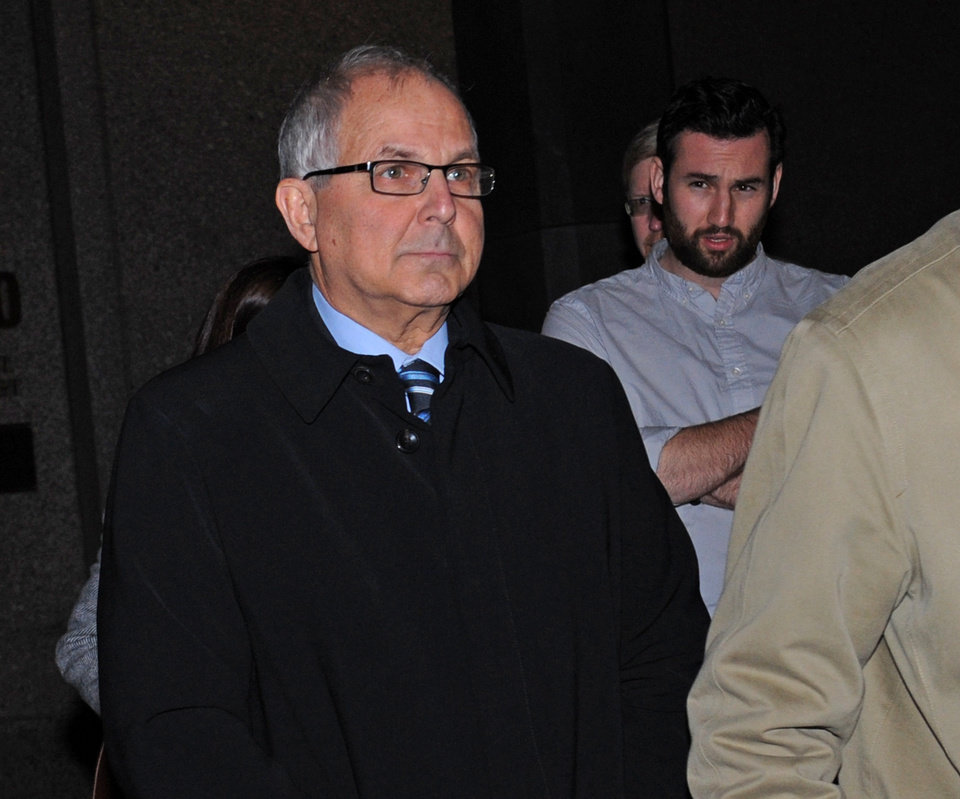 Peter Madoff exits Manhattan federal court after receiving a 10-year sentence for his participation in the largest Ponzi scheme in history, Thursday, Dec. 20, 2012, in New York. (AP Photo/ Louis Lanzano)