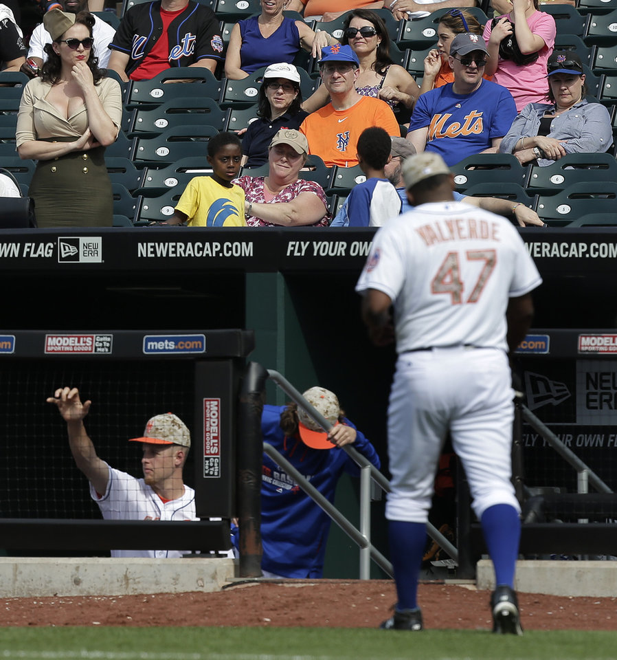 Photo - Fans watch as New York Mets pitcher Jose Valverde (47) leaves the field after giving up two runs to the Pittsburgh Pirates during the ninth inning of a baseball game, Monday, May 26, 2014, in New York. The Pirates won 5-3. (AP Photo/Julie Jacobson)