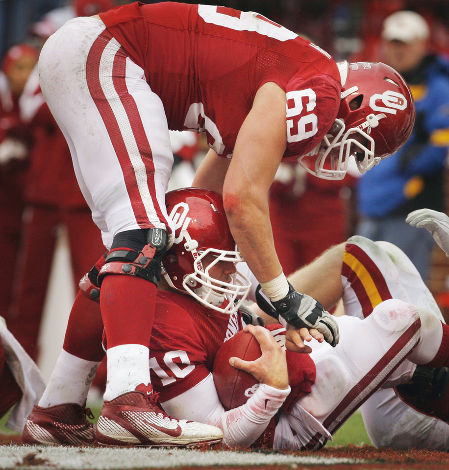 Oklahoma's Blake Bell (10) scores as Oklahoma's Lane Johnson (69) stands in the end zone during a college football game between the University of Oklahoma Sooners (OU) and the Iowa State University Cyclones (ISU) at Gaylord Family-Oklahoma Memorial Stadium in Norman, Okla., Saturday, Nov. 26, 2011. Photo by Steve Sinsey, The Oklahoman