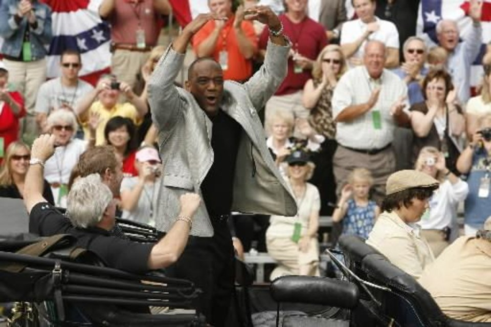 Heisman Trophy winners Steve Owens,  Billy  Sims, and Jason White ride in the Oklahoma Centennial Parade on Sunday, Oct. 14, 2007, in Oklahoma City, Okla. By STEVE SISNEY