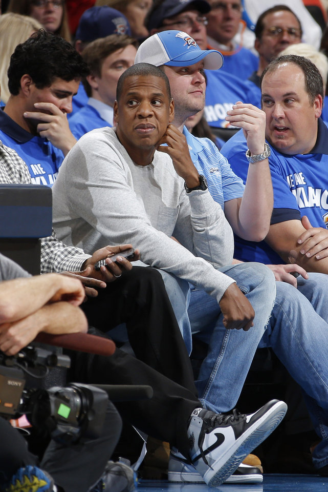Photo - Rapper Jay-Z court side during a time out of Game 2 of the Western Conference semifinals in the NBA playoffs between the Oklahoma City Thunder and the Los Angeles Clippers at Chesapeake Energy Arena in Oklahoma City, Wednesday, May 7, 2014. Photo by Bryan Terry, The Oklahoman
