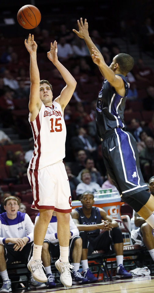 Oklahoma's Tyler Neal (15) shoots against TCU's Clyde Smith III (3) during an NCAA men's basketball game between the University of Oklahoma (OU) and Texas Christian University (TCU) at the Lloyd Noble Center in Norman, Okla., Monday, Feb. 11, 2013. Photo by Nate Billings, The Oklahoman