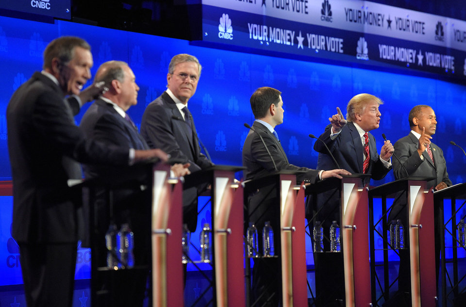 Photo - FILE - In this Oct. 28, 2015 file photo, from left, Ohio Gov. John Kasich, former Arkansas Gov. Mike Huckabee, former Florida Gov. Jeb Bush, Sen. Marco Rubio, R-Fla., Donald Trump and Ben Carson, participate in a debate for Republican presidential hopefuls in Boulder, Colo. (AP Photo/Mark J. Terrill, File)